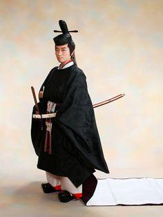 A man wearing heian robes.