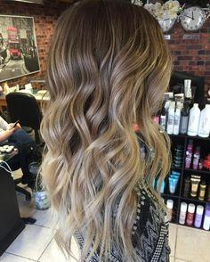 wavy dark blonde hair with light blonde balayage