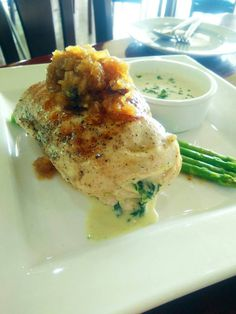 Stuffed Chicken Breast with Asparagus, white sauce and chutney.
