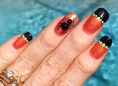 Spider accent Halloween nails.