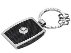 Key ring, Silverstone  Part number:     B67995156 Colour:     silver/carbon Material information:     stainless steel / carbon fibre  Silverstone key ring. Silver-coloured/black. Stainless steel. Carbon fibre inlay. Flat split ring. 3 mini split rings. 3D star logo.