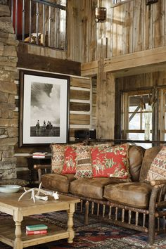 "Great looking log home living room.  I love the taupe/grey stain on the logs vs really dark or ""orange"" stain.  And, the Old Hickory leather couch and colorful cushions is really striking!  Bozeman, Montana"