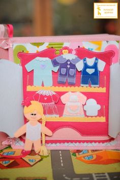 Princess paper doll clothes on this felt quiet book page by Anastasia. Such adorable and detailed work.