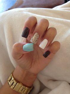 Glitter gold nail, white nail, light blue nail, and black nails