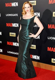 Ta-da! Christina Hendricks revealed a column dress under her ball gown at the Mad Men Black & Red Ball in L.A. on March 25.
