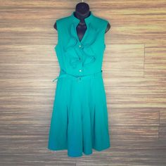 Calvin Klein teal dress Awesome condition! Worn 1 time. Zips up the side. Buttons on the front. Belt can be adjusted. Calvin Klein Dresses