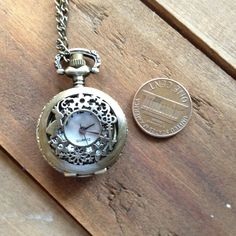 1 Pc Small Vintage Style Pocket Watch Necklace ALICE Engravings Pocketwatch CHAIN INCLUDED Alice in Wonderland. $8.00, via Etsy.