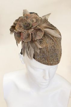 Today's creation - Harris Tweed hat decorated with a felted tweed flower and feather leaves. #SaraTiara #HarrisTweedHat #FeltedFlower #SaraTiaraHat #MadeInEngland #Handmade
