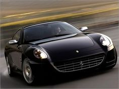 Ferrari 612...I would prefer it to be in red but...Oh, a girl can dream!