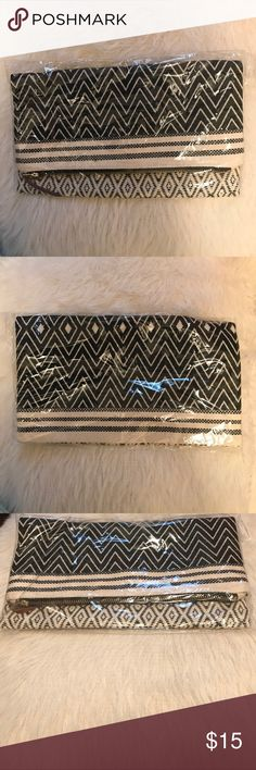 New/Sealed black and white clutch Very cute black and white clutch bag. Its completely sealed and brand new. No damages/defects.                  📍Offers are always welcome Bags Clutches & Wristlets