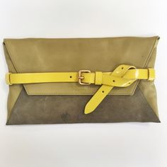 """Marc Jacobs   Tangramarama Anna Clutch This pebbled leather envelope clutch features contrast suede panels and a contrast, buckled patent strap at the front and back. Magnetic closure at front flap. Floral-lined interior features zip pocket. Please note this was used once, but has a few water spots on the suede (shown in photos). Otherwise bag is PERFECT!!  * 7""""H x 12""""L. * NO trades. *100% authentic. Marc by Marc Jacobs Bags Clutches & Wristlets"""