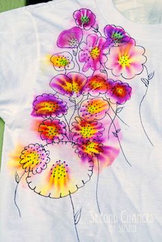 Floral Tees Rubbing alcohol bleeds Sharpie in some fun ways - you can add to a t-shirt, and then draw details over the top.