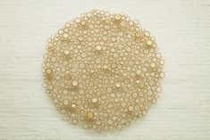 """""""Enso, crosscut bamboo and Irish waxed linen thread, 2012. Anne Crumpacker is a Portland, Oregon artist who works with bamboo and has found a unique way to use it in her work. She works with crosscut sections of bamboo and develops three-dimensional pieces that are full of depth and texture."""""""