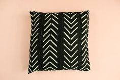 A black mudcloth featuring an off-white chevron/arrow pattern.  Front: Mudcloth from Mali  Back: Linen  Side: Zipper  Dimensions: Appx 18 inches x 18 inches. *Pillows are sold unstuffed. We recommended buying at least an inch higher for inserts.  ----------------------  Our Mudcloth Pillows are handmade in Mali & sewn in Los Angeles, CA  ----------------------  Shipping: Usually ships within 1-2 business days  ----------------------  Shop our entire collection here…