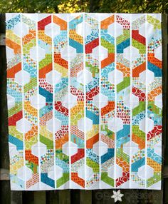 "A strip quilt offered in 4 different sizes (crib, lap, twin/full, queen) using 2-1/2"" strips. A specialty ruler is needed to complete the pattern, either the Hexagon Trim Tool or the 8-1/2"" 60 degree triangle ruler from Creative Grids or the Hex N More ruler from Jaybird quilts."