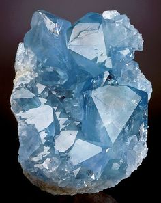 ❥ Celestine (SrSO4) cluster from Madagascar~ The mineral is found worldwide, usually in small quantities. Pale blue crystal specimens are found in Madagascar. Celestine is occasionally found in highly compressed masses that resemble Angel wings - these specimens are referred to as Angelite.