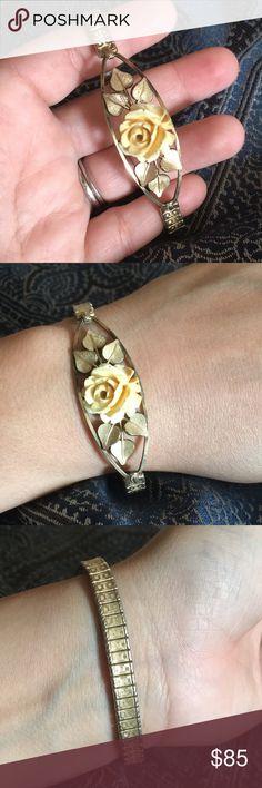 Vintage Van Dell 1/20 12kt gf bracelet Bracelet expands, spiedel marked links. As pictured. Flower may be celluloid. Some verdigris shown inside. Gold filled as marked. Vintage Jewelry Bracelets