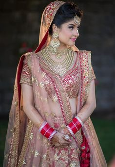 Looking for Red bridal lehenga with gold sequin work? Browse of latest bridal photos, lehenga & jewelry designs, decor ideas, etc. Designer Bridal Lehenga, Indian Bridal Lehenga, Indian Bridal Outfits, Indian Bridal Makeup, Indian Bridal Fashion, Indian Bridal Wear, Indian Wedding Bridesmaids, Bridal Dresses, Indian Wedding Sari