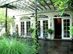 Love the shape of these french doors. Good use of green space