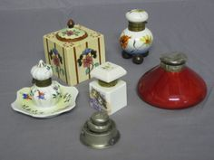 """A Royal Doulton flambe circular inkwell 4"""" with silver lid, together with 3 porcelain inkwells, a pottery inkwell and a metal inkwell"""