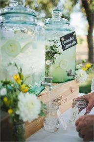 lemonade jugs for the Shabby Chic Outdoor Shower (I own one that would be perfect on a tablescape similar to this one) (love how they put the jugs on a piece of wood and not overhanging the table!)