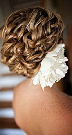 Curly side swept bun for the bride