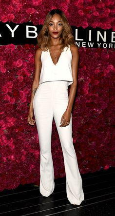 Celebrity Style at NYFW Spring 2016 - Jourdan Dunn in a V-neck crop top and matching white high-waisted flares | @StyleCaster