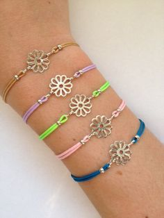 Items similar to Flower Charm Bracelet with nylon cord and adjustable size on Etsy Japanese Ornaments, Flower Bracelet, Different Colors, Lilac, Cord, Jewlery, Charmed, Turquoise, Bracelets