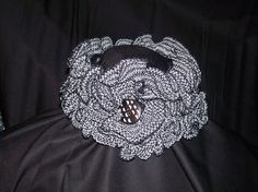Knitted ruffled scarflette