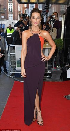 Gorgeous as ever: Kate Beckinsale looked incredible in a dark purple dress as she attended...