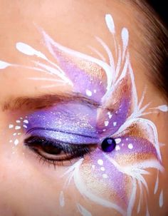 Beautiful floral eye face paint design.