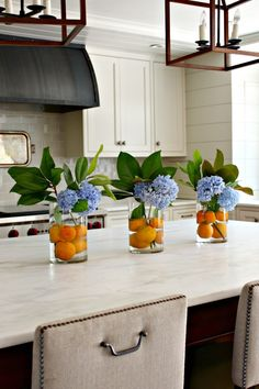Make this simple Hydrangea Arrangement with oranges, magnolia stems and hydgrang. Make this simple Hydrangea Arrangement with oranges, magnolia stems and hydgrangeas and immediately add summer to your kitchen!