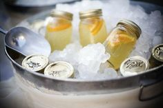 Lemonade in Canning Jars on Ice!!  This would be great for a summer party. . . (could also make half sweet tea!)