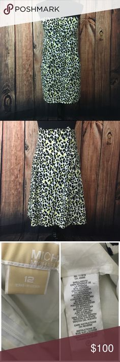 "Michael Kors yellow leopard dress Gorgeous structured dress has removable straps so it can be worn with or without straps; very light wear no stains or tears, total length is 27"" offers are always welcome in my closet, bundle 2 or more items and receive 15% off! MICHAEL Michael Kors Dresses Mini"
