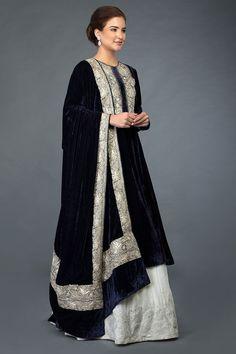 "From "" NOOR"", our new collection of Kashmiri tilla embroidery adorned silk velvets, this is a midnight blue silk velvet kurta and dupatta paired with an ivory silk velvet lehenga skirt. The midnight blue silk velve Designer Dress For Men, Indian Designer Outfits, Designer Dresses, Indian Wedding Guest Dress, Indian Bridal Wear, Salwar Neck Designs, Lehenga Designs, Pakistani Outfits, Indian Outfits"