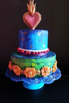 """Mexican Wedding Cake (Frida K. inspiration ) """"Sacred Heart Milagrito"""" cake topper with cempazuchil flowers bottom tier."""