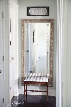 how-to-decorate-the-end-of-a-long-hallway-with-a-mirror-or-artwork-photo-via-makerista