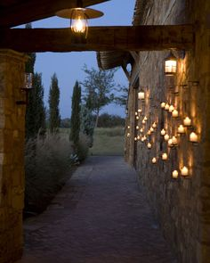 Neat way to decorate an exterior stone wall. Outdoor Candles, Outdoor Lighting, Outdoor Decor, Hacienda Style, Southwestern Style, Exterior Lighting, Landscape Lighting, Spanish Style, Interior Exterior