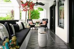 Suzie: Kishani Perera - Chic black & coral deck patio design with glossy white garden stools, ...