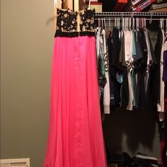 Black and hot pink prom dress Bought as a size 4 but altered and hemmed. I'm 5'1 but I had heels on that day so it would work for any body 5'1-5'5. Only worn once minor tear near top of slit that could be fixed by seamstress MAKE OFFER want this out of my closet so please offer or comment I M willing to negotiate price  Dresses Strapless