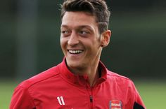 Arsenal's Mesut Ozil says he loves London and is grateful for the support from manager Arsene Wenger