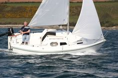 """Whether you want to cruise to your next destination at 55 mph or are striving for simplicity, this fleet of trailer-sailers and pocket cruisers will fit your needs and budget. """"Boat Reviews"""" from our May 2012 issue."""