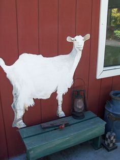 GOAT PAINTED ON THE SIDE OF THE BARN. WOODWARD FARM