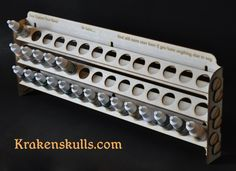 This is an easy to assemble, vertical rack for the typical 17ml bottles used by many manufacturers including Vallejo and Reaper. It holds 42 of the dropper style containers, and may hold other bott…