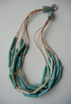 "Idea: Combine faux turquoise and leather! Each lends authenticity to the other. ""South Western Wind"" Faux turquoise, glass and leather necklace. Paper Jewelry, Paper Beads, Beaded Jewelry, Handmade Jewelry, Polymer Clay Necklace, Polymer Clay Beads, Turquoise Jewelry, Turquoise Glass, Leather Necklace"