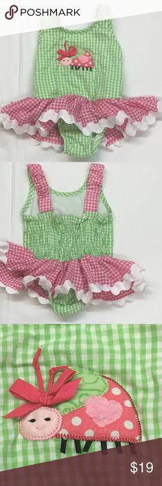 """Mud Pie baby seersucker ruffle ladybug swim suit. Adorable pink and green seersucker one piece swim suit by Mud Pie. Size listed as 2t-3t. 100% cotton with elastic back and straps and ruffle skirt. chest: 9"""" Length: 15"""". Inside pictures so show EUC. Mud Pie Swim One Piece"""