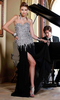 Long strapless dress with sequin embellished bodice and slit.