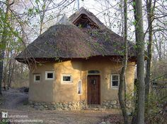 This beautiful Straw Bale Studio is in Oxford, MI, USA. It's a place to learn about natural building skills and sustainable living. The straw bale home has a thatched roof, earthen plasters with natural paints and uses solar electricity. Find something new every day on the Natural Homes Timeline http://naturalhomes.org/timeline.htm