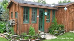 garden sheds: (skip the little micro fence), green trim, paved entryway