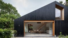 Black wood barn by Workshop Architecten houses livestock and people